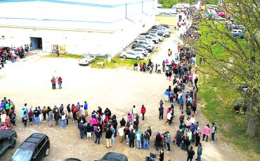 The Bread and Cheese line snaked around the arena to the road. ( Photo by Jim C Powless)
