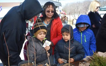 Students from Kawenni;io/Gaweni:yo Elementary School dropped by Turtle IslandNews' Earth Day Festival and had a chance to learn about plants and trees from Stefan Weber a ecologist with the St. Williams Nursery & Ecology. (Photo by Neil Becker)