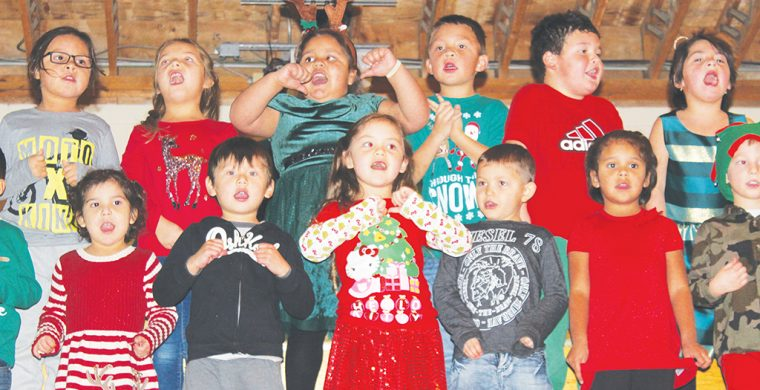 Jamieson Kindergarten students belt out a Christmas tune during their annual Christmas concert. Photo by Donna Duric.