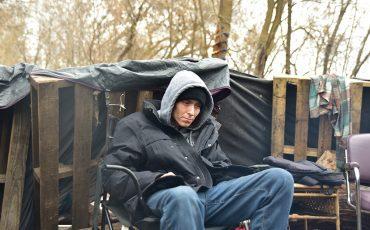 Richard Carpenter, 34, watches the campfire slowly burn. (Photo by Jim C Powless)