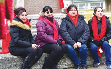 (Left to Right) Debra Jonathan, Ellie Hill, Kim Logan, Paula Maracle. Red Scarf Day organizers from Six Nations Health Services spent time out in the cold decorating Veterans Park with 188 red scarves. (Photo by Jim C Powless)